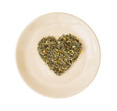 Heart of loose tea on the plate, Valentine's day, isolated Royalty Free Stock Photography