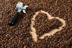 Heart in a lot of coffee beans with heart. With portafilter Royalty Free Stock Photos