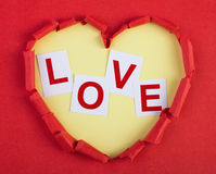 Heart with love. Paper heart with graved capton love in it Royalty Free Stock Photos