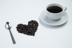 Heart of love with  cup coffee. On the white background Royalty Free Stock Photography