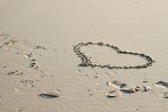 Heart of love drawn in the sand. A heart of love drawn in the sand of the dutch beach along the Northsea coast Royalty Free Stock Photo
