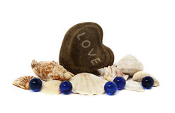 Heart love seashells blue stones Royalty Free Stock Photo