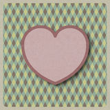 Heart love shape on retro background made from recycled paper cr Royalty Free Stock Image
