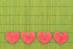 Heart and love symbol against bamboo sticks Stock Photos