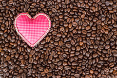 Heart love symbol on coffee beans Royalty Free Stock Images