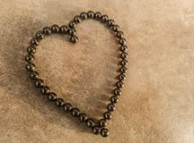 Heart of love symbol in magnetic ball bearings royalty free stock images