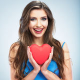 Heart, love symbol young happy woman hold. Isolated on studio b Royalty Free Stock Images