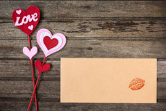 """Heart"" and ""Love"" valentine decoration and brown envelo Royalty Free Stock Photography"