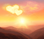 Heart, love and Valentines day. Two Valentines hearts in the sky. Sunset in the mountains stock photography