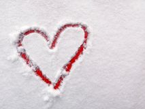 The heart of lovers in the snow. Heart is a symbol of love. Valentine`s Day Royalty Free Stock Images