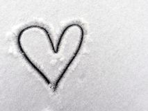 The heart of lovers in the snow. Heart is a symbol of love. Valentine`s Day Royalty Free Stock Photo
