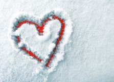 The heart of lovers in the snow. Heart is a symbol of love. Valentine`s Day Royalty Free Stock Photography