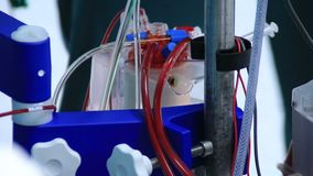 Heart lung machine pumping blood in operating room stock footage