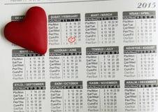 Heart lying on the calendar Stock Photo