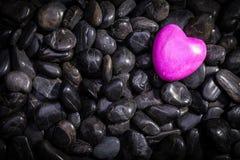 Heart lying on stones Stock Photography