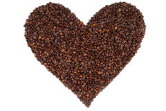 Heart made ​​from coffee beans. Heart made ​​from coffHeart made ​​from coffee beans isolated on white background.ee stock image