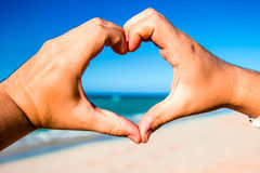 Heart made ​​of hands Stock Images