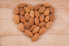 Heart made of almonds Royalty Free Stock Images