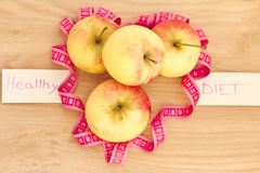 Heart made of apples and measuring tape Stock Photo