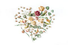 Heart made with beige roses and green leaves Stock Images
