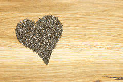 Heart made of black chia seeds Royalty Free Stock Images