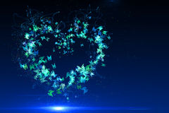 Heart made of blue butterflies. Stars and dots Stock Photo