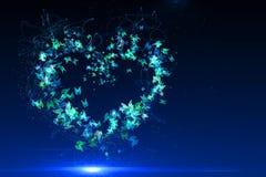Heart made of blue butterflies Stock Photo