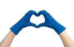 Heart made of blue medical gloves. Isolated on white background. Thanks to health workers concept, medical staff concept. Thank