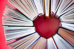 Heart made from books on pink background. Close up view. Love story concept stock image