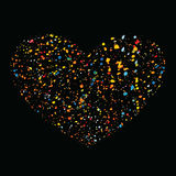Heart made of bright splashes and spots on a black background. Stock Images