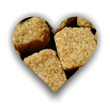Heart made of brown sugar cubes Stock Image