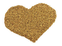 Heart made from buckwheat Stock Photography