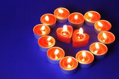 Heart Made of Candles. Heart Made of Burning Candles on Spotty Blue Background Stock Images