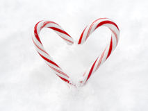 Heart made of candy canes in snow Stock Photo