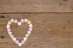 Candy hearts on Barn Wood stock photo