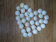 Heart made of candy on wooden floor royalty free stock images