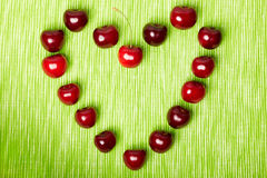 Heart made of cherries Royalty Free Stock Image
