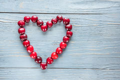 Heart made of cherries Royalty Free Stock Photography
