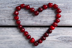 Heart made of cherries. Royalty Free Stock Images