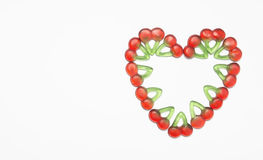 Heart made of cherries on a white background Stock Photos