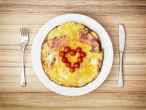 Heart made of cherry tomatoes on the ham and eggs for valentines Stock Photo