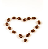 Heart made with chocolate covered peanuts Royalty Free Stock Photography