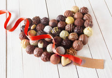 Heart made with chocolate truffles and a tag Stock Photography
