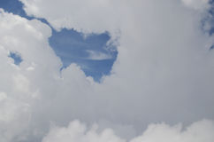 Heart made of clouds over blue sky Royalty Free Stock Photography