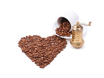 Heart made of coffee beans. Composition of heart made of coffee beans and coffee grinder Royalty Free Stock Photography