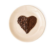 Heart made of coffee beans and ground coffee on the plate, Valen Stock Photos