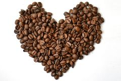 Heart made of coffee beans top view. Love coffee background isolated. royalty free stock image
