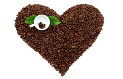 Heart made from coffee beans on white background. Stock Photo
