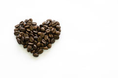 Heart made of coffee beans on white background, love coffee Royalty Free Stock Images