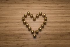 A heart made of coffee capsules. Tilt view with wooden background Royalty Free Stock Images